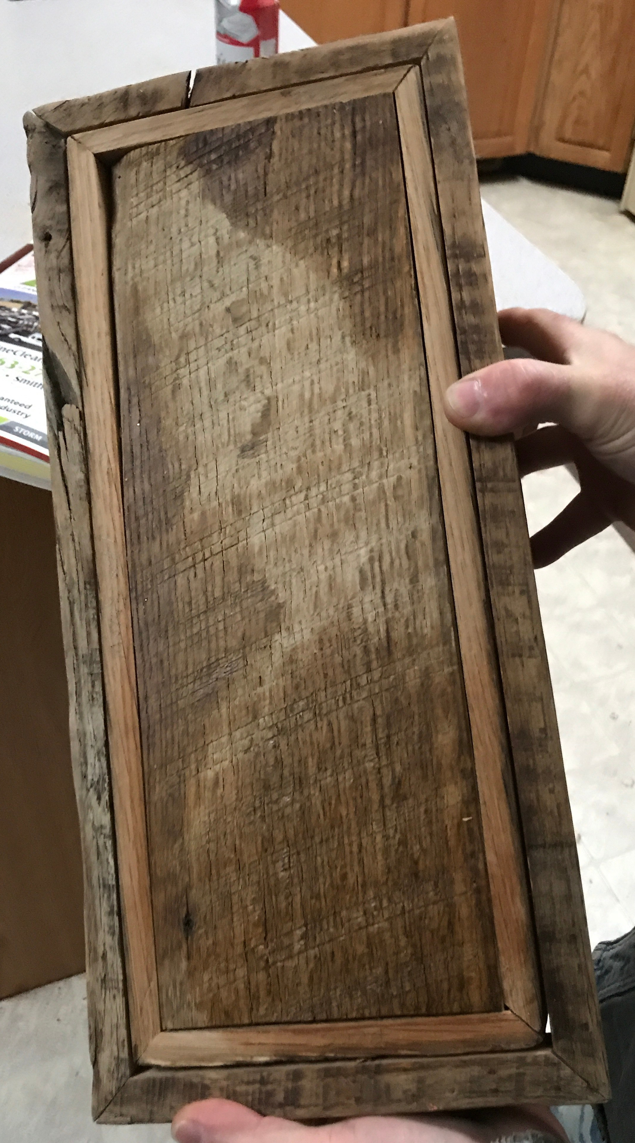 The underside of an park barn wood box with mitered framing with beeswax, tung oil and home made wax in three different spots