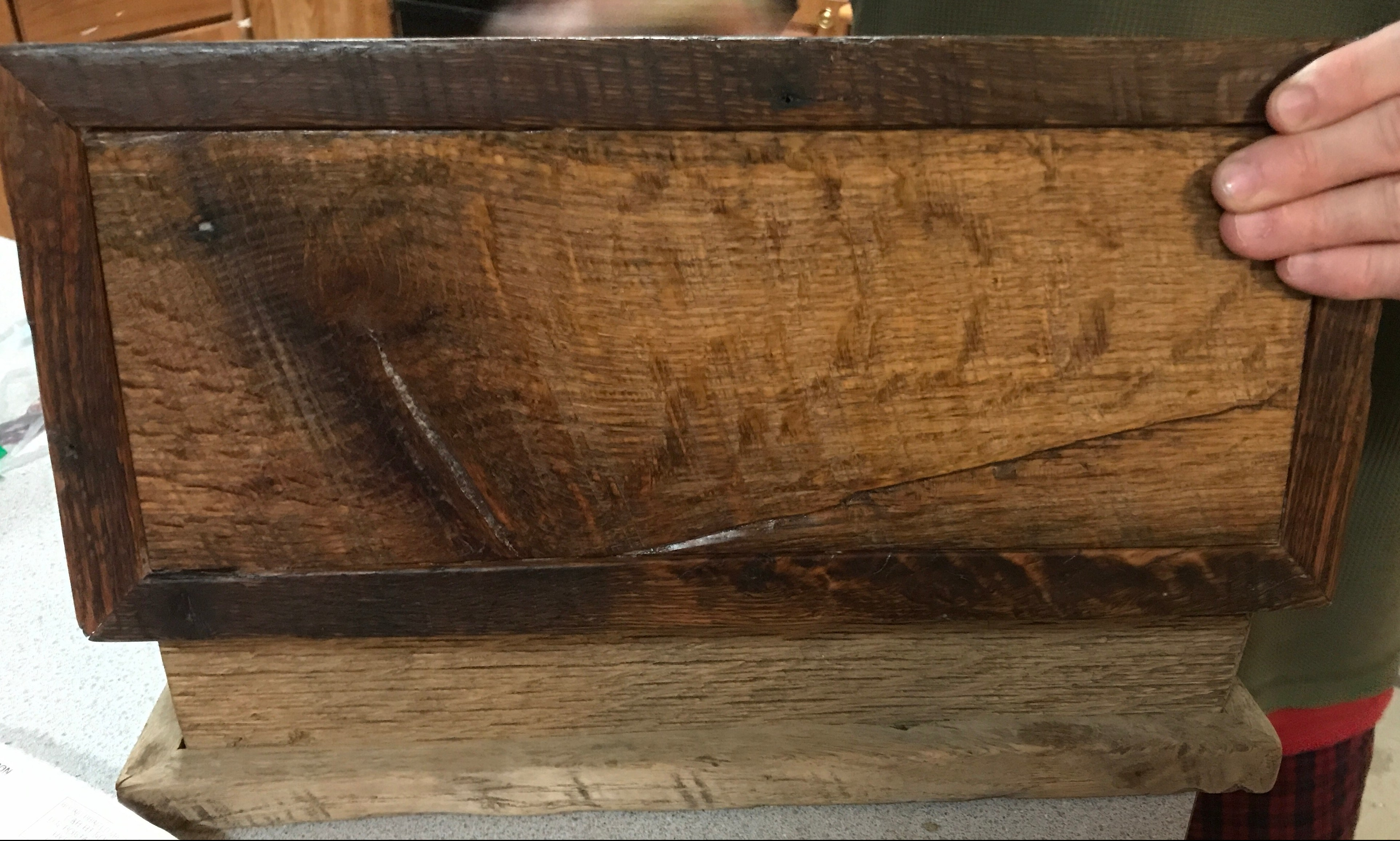 A solid oak wooden box with the top lifted up on its hinges, and the top has been oiled using home made wax with the bottom pox part not waxed