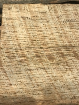 A close up of old oak barn wood after it had been washed and skip sanded with saw tooth marks