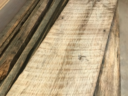 An old piece of grayed oak wood cladding taken off a barn in Montana with black nail holes