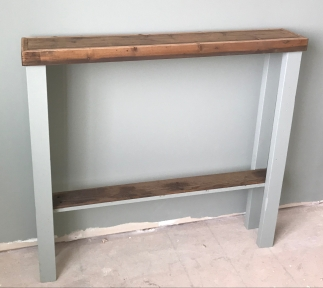 Skinny reclaimed wood table with a dark walnut stain and green gray painted legs