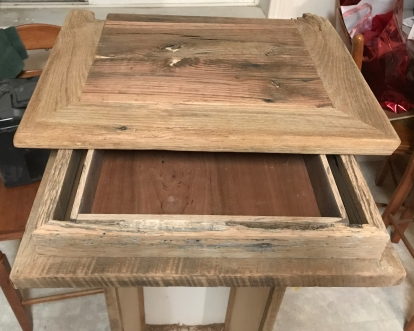 drawer disguised as Oak cabinet molding with original saw tooth marks