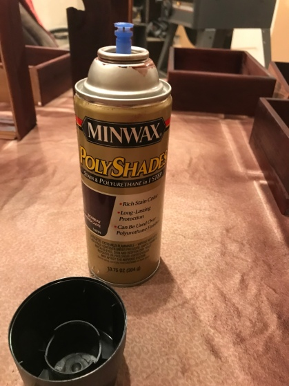 Minwax Polyshates Bombay Mahogany Spray Can with the lid off and drawer boxes that had been sprayed with this product in the background