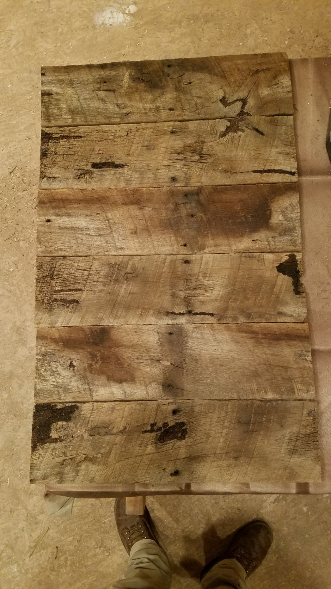 Reclaimed oak barn wood with saw tooth marks, knots and stains.