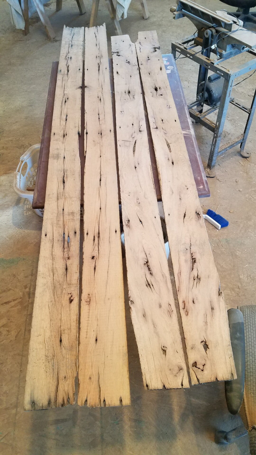 the clean sliced back of four reclaimed oak barn wood boards, two sets that are book matched.