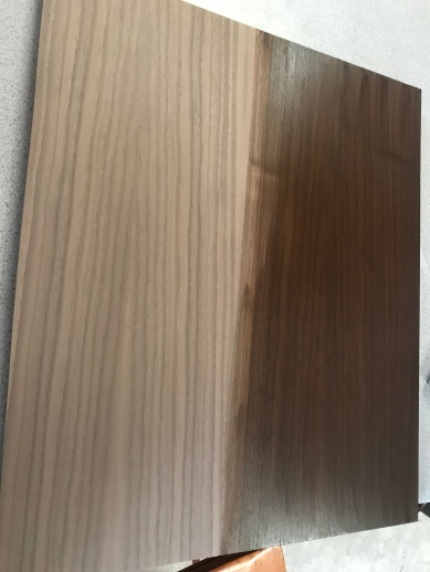 Walnut Veneer wood with the left side left the natural color and the right side stained a dark walnut color