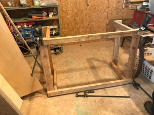 A square table frame made of 2x4's in a workshop