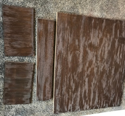 Walnut Veneer wood with a dark walnut stain and a layer of poly that has been sanded
