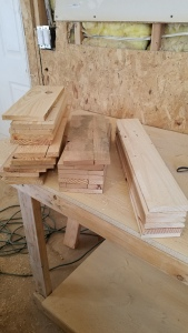 Reclaimed pine pallet wood cut to size and planed sitting on a work bench in a wood shop