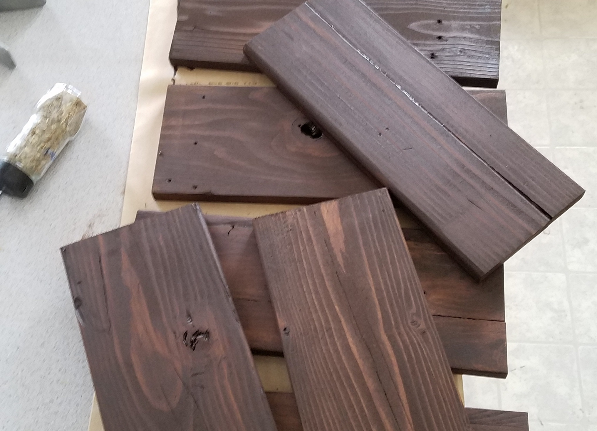 Reclaimed pallet wood pieces stained a dark walnut color