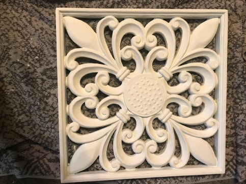 White painted fleur de lis wall art