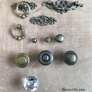 Drawer pulls of various sizes and shapes featuring small round jewelry box pulls, bohemian round dangly pulls and ordinary round pulls
