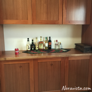 Mahogany built in cabinets with a mahogany counter top and a liquor collection on top