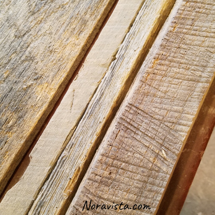 Reclaimed oak barn wood up close view before milling
