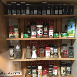 A decorative spice rack with organized cooking spices