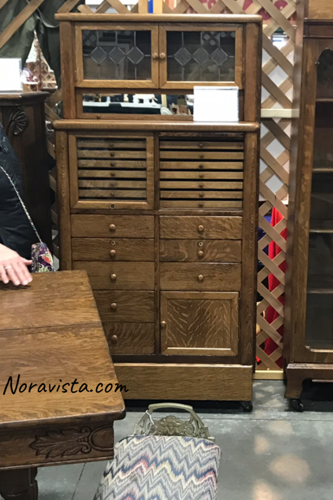 Antique oak apothecary cabinet at a vintage fair