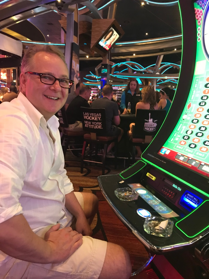 Man in a casino at the digital roulette
