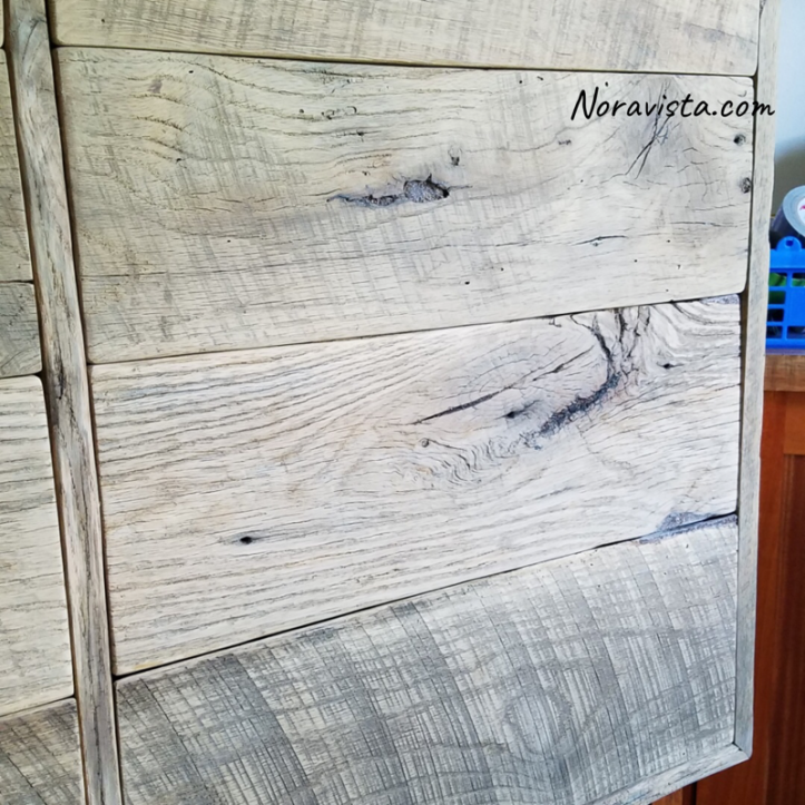 A reclaimed oak barn wood cabinet with saw tooth marks and cathedrals