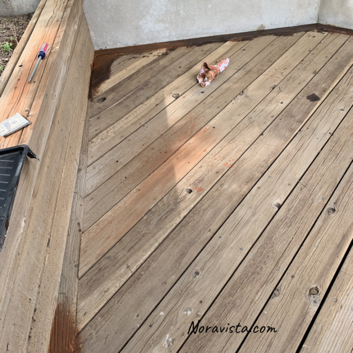 Redwood deck with orang and brown stain