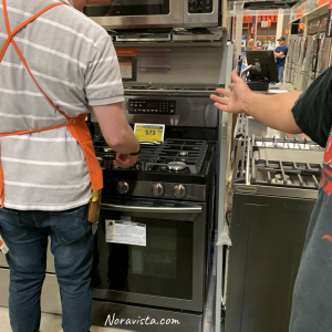 A new gas oven/stove in the store with a price tag on it