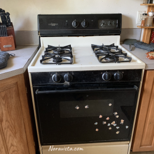 An old beige gas oven/stove