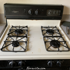 An old beige gas oven/stove.