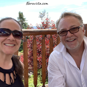 A man and woman sitting outside at Cooper's Bear Lake West